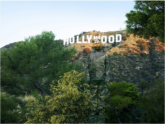 SSPNY first looks at an artwork from Hiding in California, where  an individual is hidden in front of the iconic Hollywood sign.