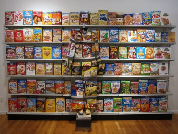 SSPNY checks out one of the many jaw dropping pieces of Liu Bolin's Hiding series exhibit. As seen here, an individual is overwhelmed and pushed behind consumerist society represented by a bunch of cereal boxes.