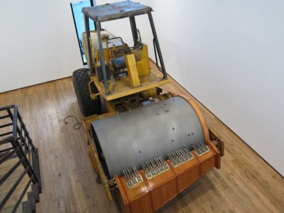 "SSPNY Checks Out Dodge Gallery on Rivington for a Variety of Odd Sculptural Pieces from ""Early Career"" Artists, Making Good Use of its Duplex Layout by Putting Pieces in it Such as This Steamroller-Slash-Music Box Downtairs."