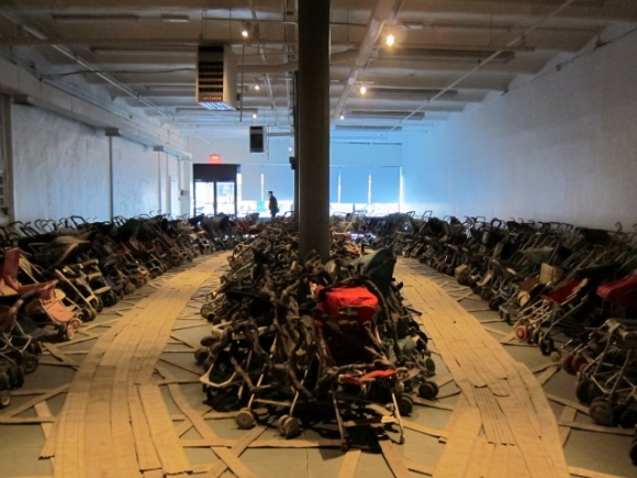 SSPNY checks out all five floors of the New Museum's gallery, named after a Sonic Youth album, and even spills over into the annex next door Studio 231, which now holds an installation by Nari's Ward called Amazing Grace that consists of dozens of discarded and filthy baby strollers strapped together fire hoses and assembled into the shape of a ship with Mahalla Jackson's version of Amazing Grace playing in the background.