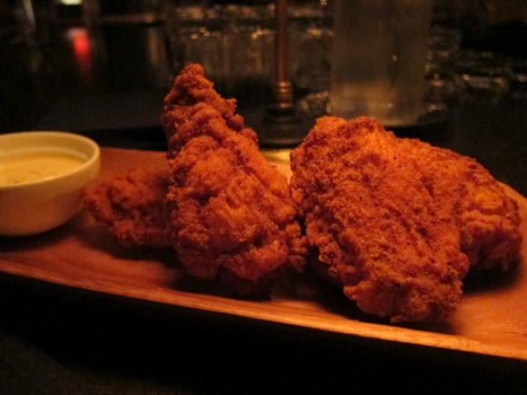 SSPNY reviews The Public Theater's new restaurant The Library by Andrew Carmellini has starters such as the Chicken-Fried Chicken Wings, perfectly cooked in East Village