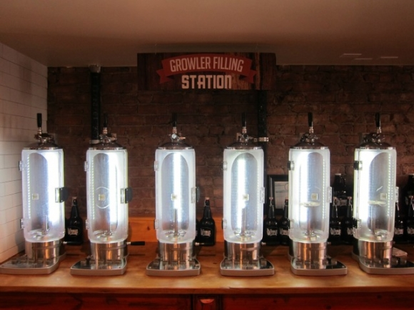 Below the Textile Arts Center is the Growler Station where they offer a filling station to bring home your choice of over 20 well-curated craft beers on tap.